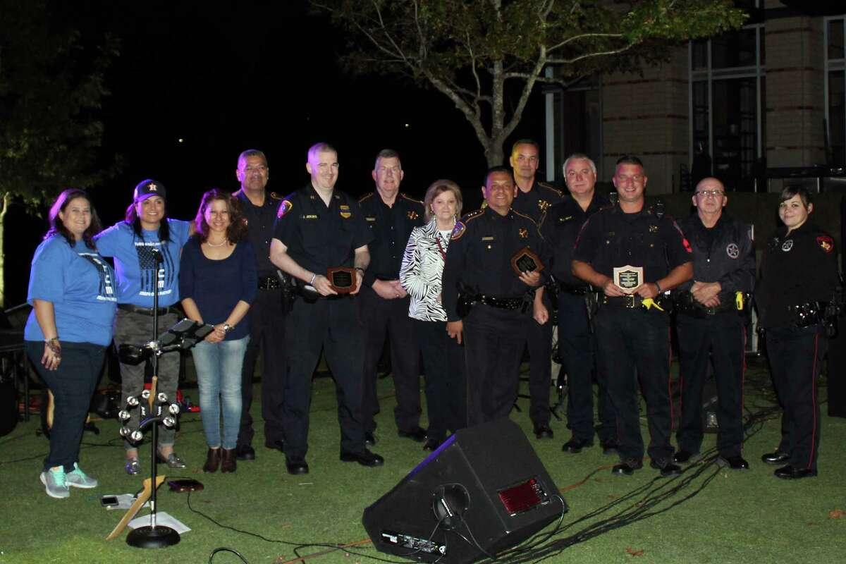 First responders across multiple agencies are honored during Turn Kings Harbor Blue in Kingwood on Friday, Nov. 10.