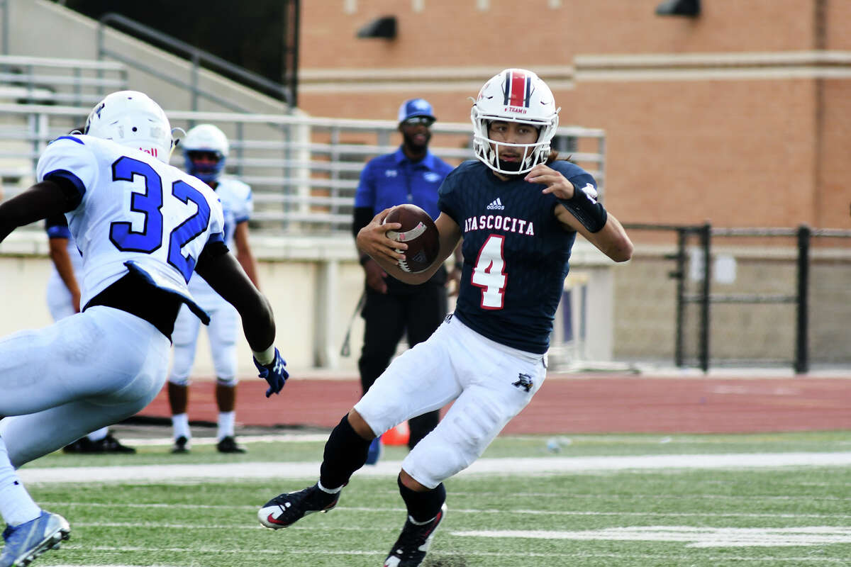 Atascocita senior quarterback Jack Roe (4) works for extra yardage against C.E. King defender Charles Melanson (32) in the first quarter of their District 21-6A matchup at Turner Stadium in Humble on Nov. 4, 2017. (Photo by Jerry Baker/Freelance)