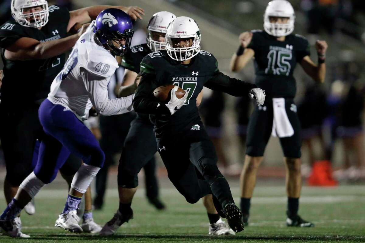 Kingwood Park Panthers running back Immanuel Mcelroy jr (17) rushes for a touchdown in the fourth quarter during the high school football game between the Humble Wildcats and the Kingwood Park Panthers in Humble, TX on Friday, November 10, 2017.