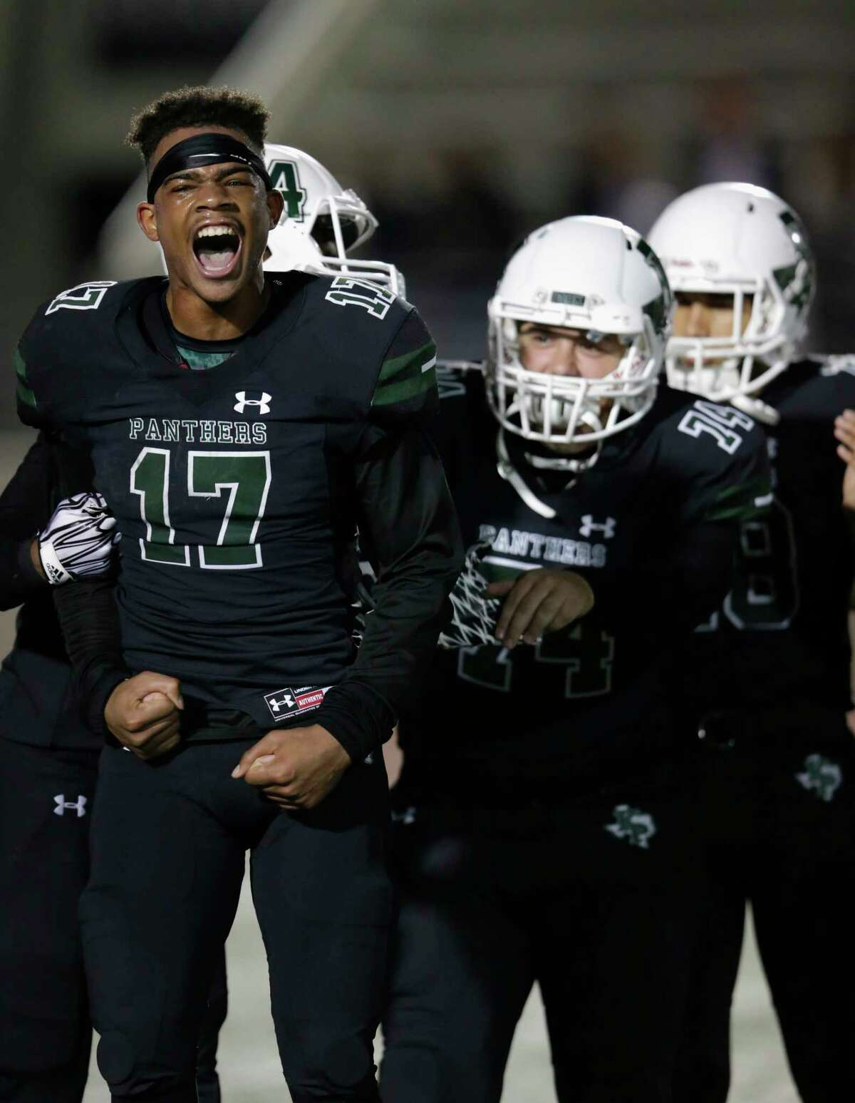 Kingwood Park Panthers running back Immanuel Mcelroy jr (17) celebrates with Gavin McGehee (74) after the high school football game between the Humble Wildcats and the Kingwood Park Panthers in Humble, TX on Friday, November 10, 2017.