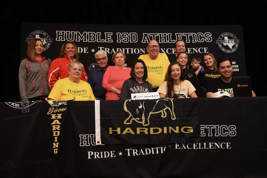 Lauren Bazan, front row center, who plays softball for Atascocita High School, signs with Harding University during the Humble ISD Signing Day Ceremony at Charles Bender Performing Arts Center in Humble on Nov. 8, 2017. (Photo by Jerry Baker/Freelance) Photo: Jerry Baker, Freelance / Freelance
