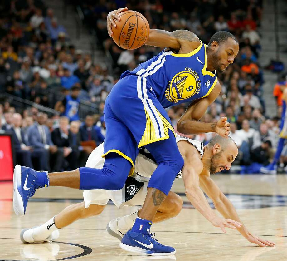 Golden State Warriors' Andre Iguodala and San Antonio SpursÕ Manu Ginobili chase after a loose ball during first half action Thursday Nov. 2, 2017 at the AT&T Center. Photo: Edward A. Ornelas, San Antonio Express-News