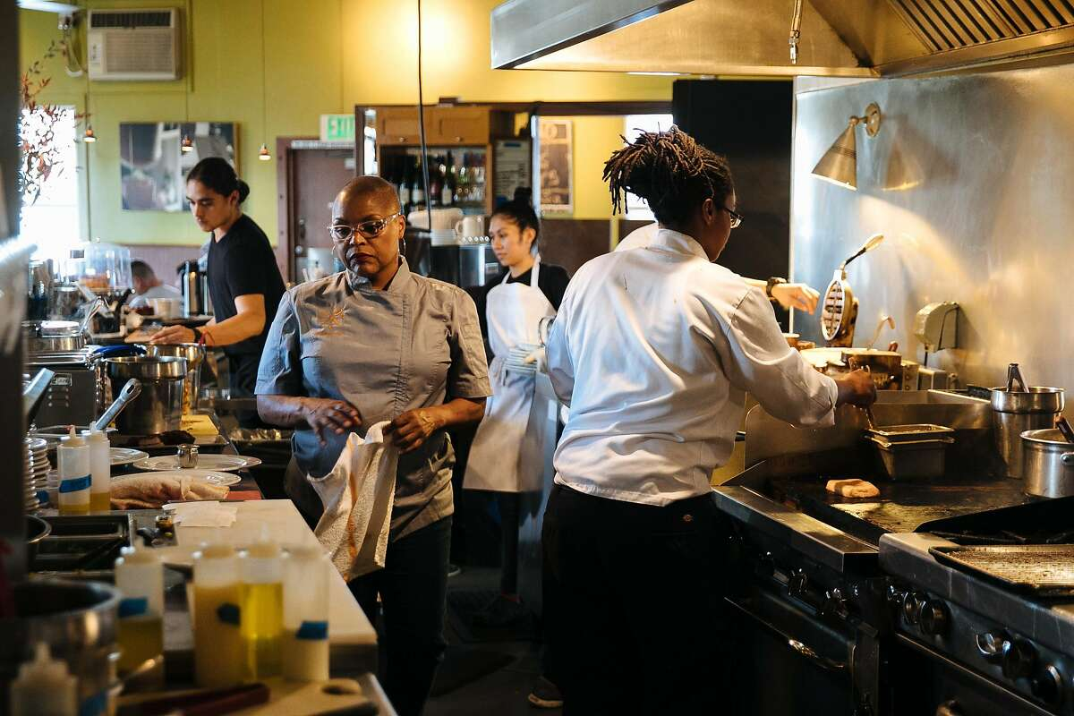 FILE-- Tanya Holland helps her staff prepare food at her restaurant, Brown Sugar Kitchen, in Oakland on Nov. 10, 2017.After more than a decade as a favorite hangout for locals, tourists, rap artists and Golden State Warriors players alike, Tanya Holland's iconic West Oakland soul food spot, Brown Sugar Kitchen, will soon cease to exist in its current form.