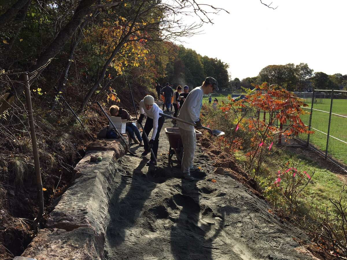 Volunteers from Friends of East Rock Park and the Urban Resources Initiative did the hard work of putting in a trail at Rice Field to better connect the Cedar Hill and East Rock neighborhoods.