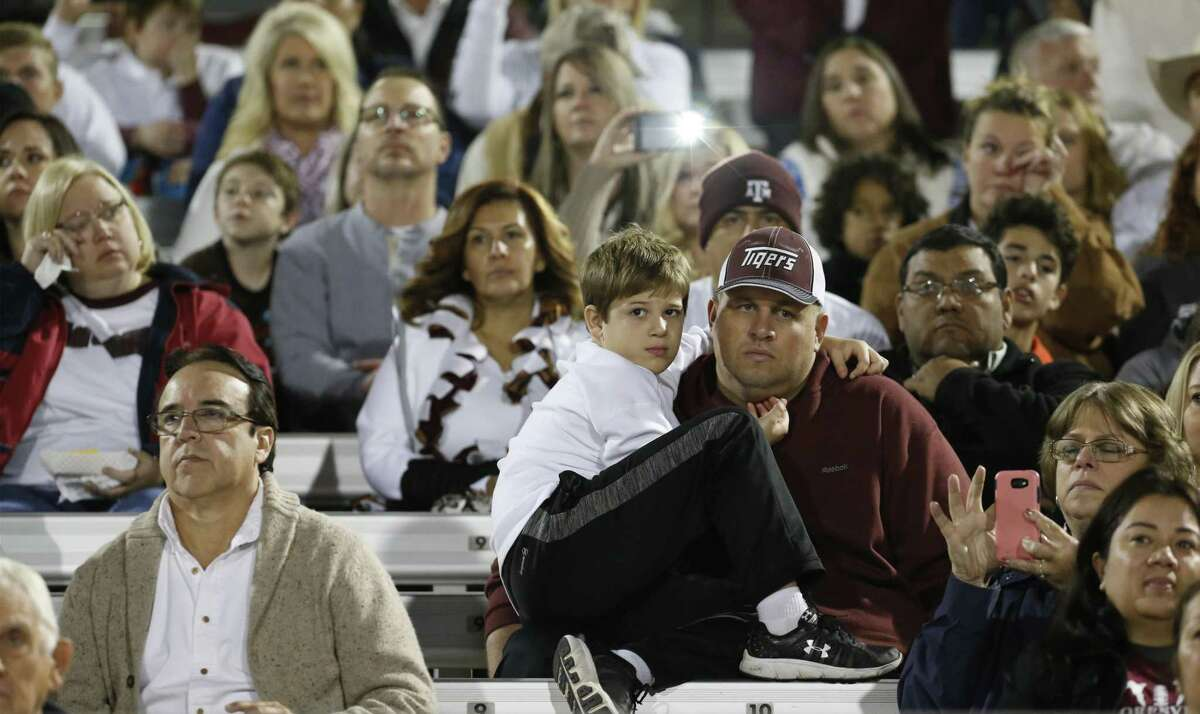 Floresville High School fans appear somber during the playing of Amazing Grace by the high school and middle school band to honor the shooting victims of Sutherland Springs during halftime of the game against Southside during their District 29-5A title game in Floresville on Friday, Nov. 10, 2017. (Kin Man Hui/San Antonio Express-News)