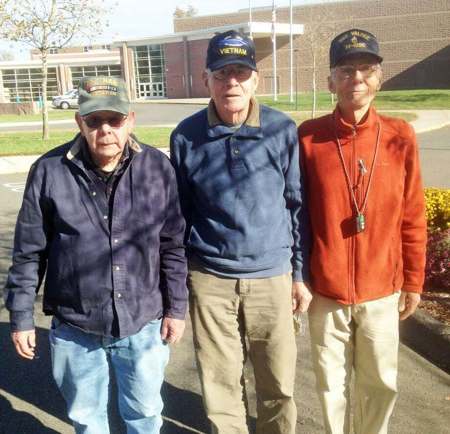 Portland High School 10th-graders met veterans Rodney Spooner, Reg Farrington and George Swanson last week. All have links to Portland. Photo: Jeff Mill / Hearst Connecticut Media