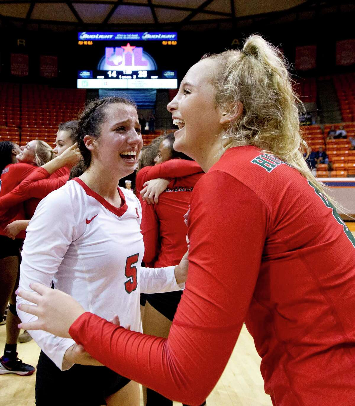 The Woodlands' Georgia Murphy (5) reacts with Sophie Walls (8) after defeating College Park 3-1 during a Region II-6A final volleyball match at Johnson Coliseum, Saturday, Nov. 11, 2017, in Huntsville.