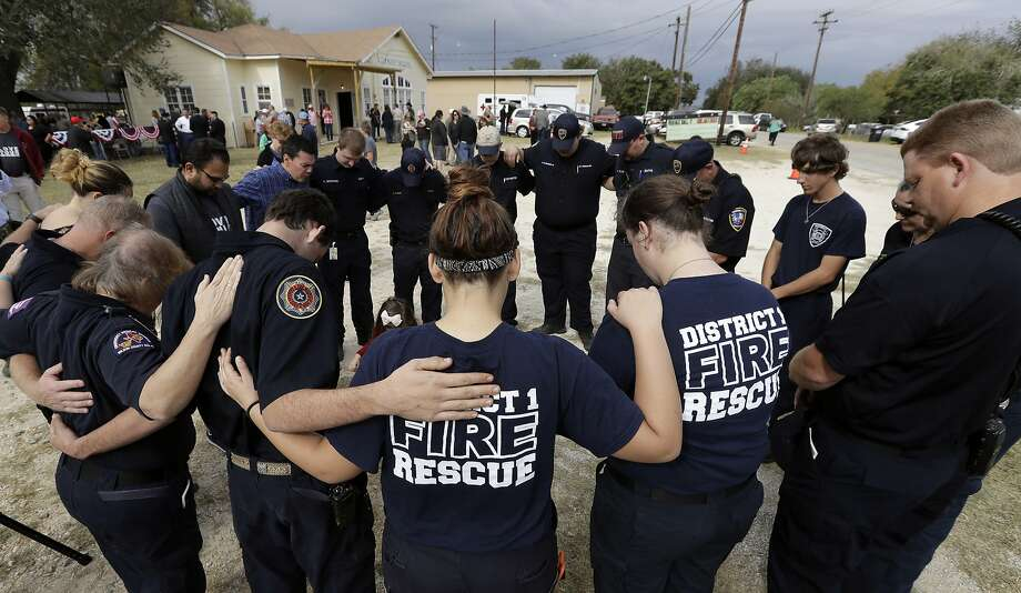 First responders join in prayer after a Veterans Day tribute in Sutherland Springs, Texas, where 25 people were killed. Photo: Eric Gay, Associated Press