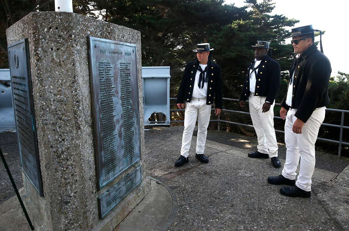 Sailors from the Constitution, wearing U.S. Navy uniforms from 1813, visit the USS San Francisco Memorial after serving as the color guard for a Veterans Day ceremony to commemorate the 75th anniversary of the Battle of Guadalcanal in November 2017.