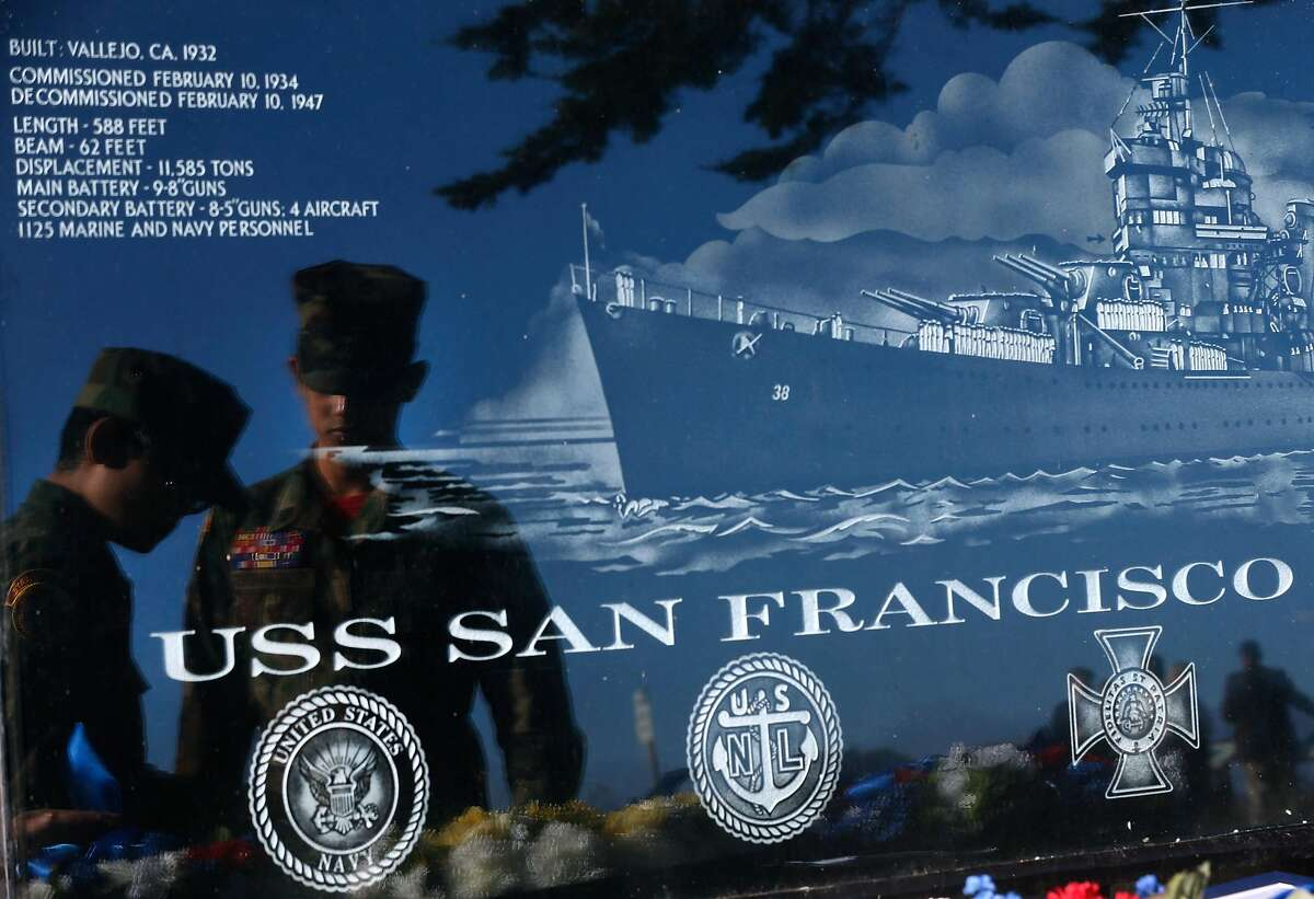 Joseph Consolino (left) and Tylaw Villacarlos, members of the Golden Gate Young Marines group, are reflected in a marble marker at the USS San Francisco Memorial while preparing wreathes for a Veterans Day ceremony to commemorate the 75th anniversary of the Battle of Guadalcanal in San Francisco, Calif. on Saturday, Nov. 11, 2017.