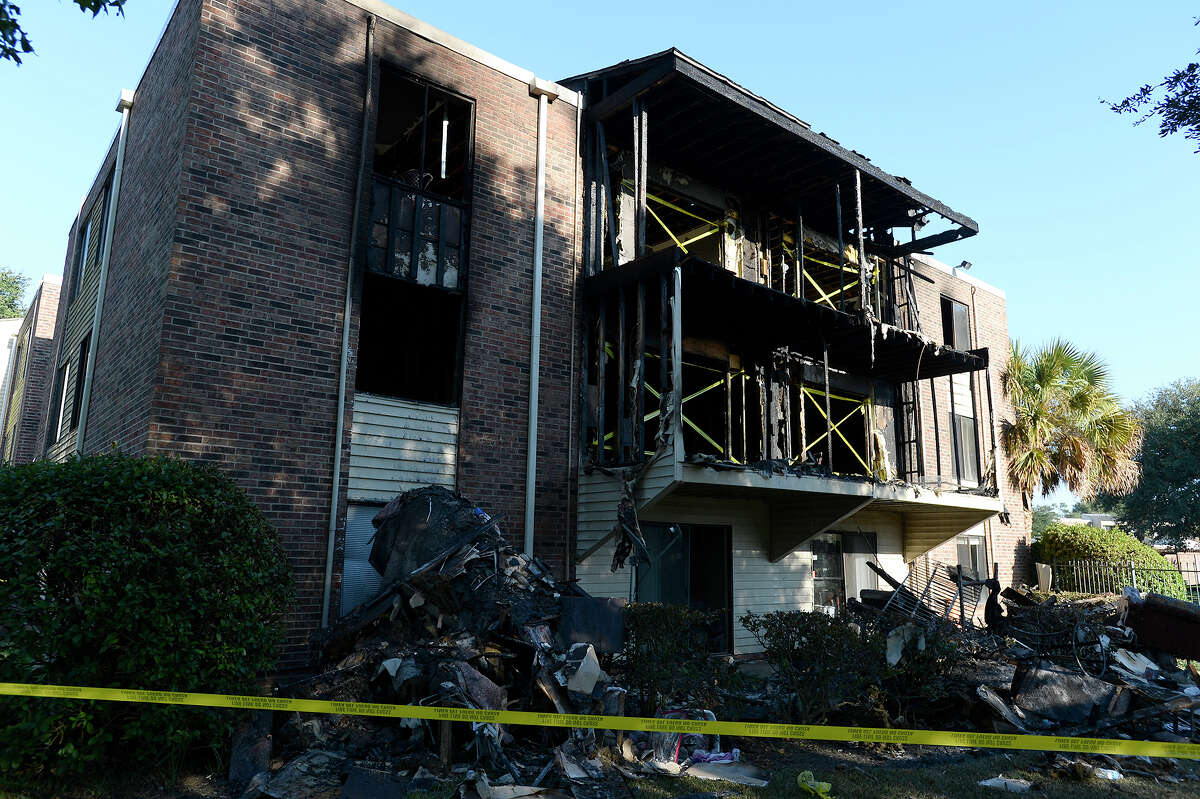 A fire destroyed a building at the Glen Oaks apartment complex on Dowlen Road on Saturday morning. Residents of 50 apartments were displaced, according to Capt. Jimmy Blanchard with Beaumont Fire/Rescue. Blanchard said the fire was started by a child playing with a lighter. Four people, including one police officer, received minor injuries, according to Blanchard. Photo taken Saturday 11/11/17 Ryan Pelham/The Enterprise