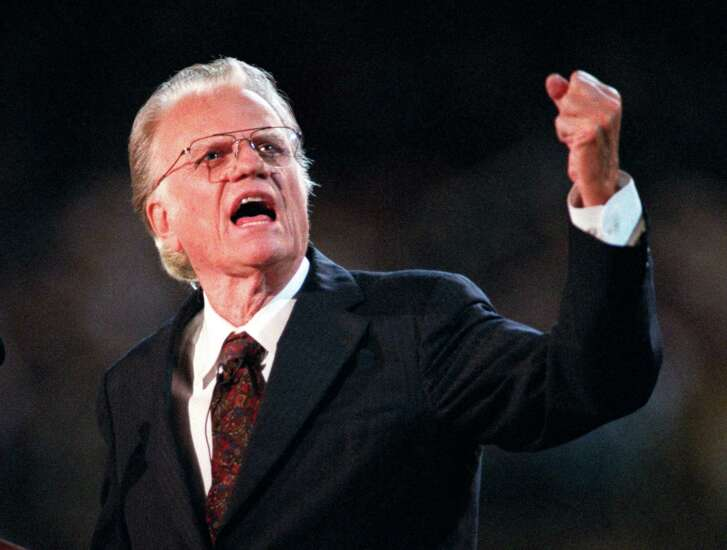 Billy Graham preaches during his 1996 crusade in his hometown of Charlotte, N.C. He held four crusades here. From the first one, in 1947, to the last one in 1996, the evenings of music and sermons would build toward Graham's altar call. Hundreds would come forward to give their lives to Jesus Christ. (John D. Simmons/Charlotte Observer/TNS)