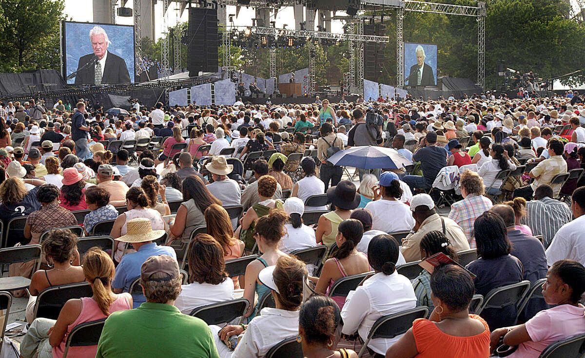 Billy Graham addresses a crowd Sunday at Flushing Meadows Corona Park in New York on the last day of a three day crusade, Sunday, June 26, 2005.