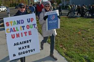 A march against hate and bigotry organized by Scott Milnor, left, and Susan Cutler, right, moves through Wilton Center from the Wilton Train Station Saturday, November 11, 2017, in Wilton, Conn. While their specific act of protest is a reaction to the anti-Semitic note found on a sixth-grader's locker at Middlebrook, Saturday's march is aimed at all acts of intolerance, bigotry and hate.