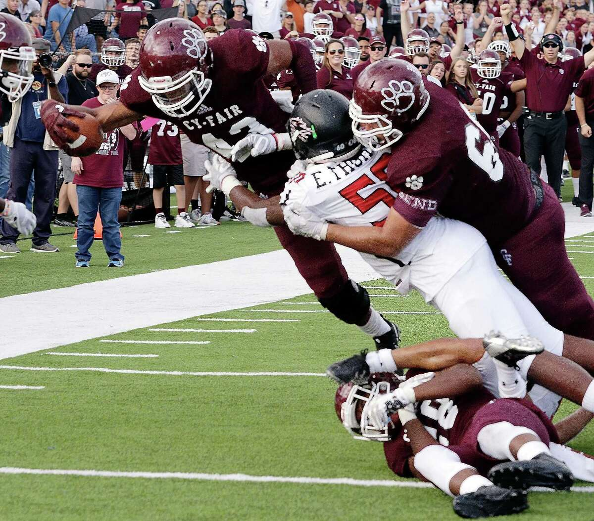 Cy-Fair's Trenton Kennedy (43) dives into the end zone for the game winning touchdown despite Langham Creek's Ernest Thomas (50) during the second half of their game Saturday, Nov. 11, 2017, in Houston, TX. (Michael Wyke / For the Chronicle)
