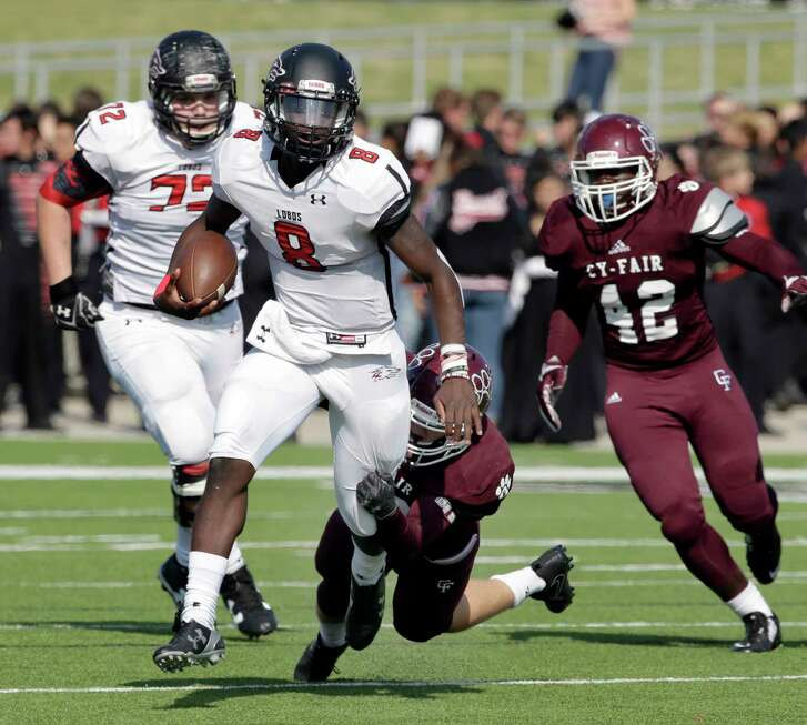 Langham Creek quarterback Chris Herron (8) is caught by Cy-Fair's Patrick Atkinson (30) during the first half of their game Saturday, Nov. 11, 2017, in Houston, TX. (Michael Wyke / For the  Chronicle)