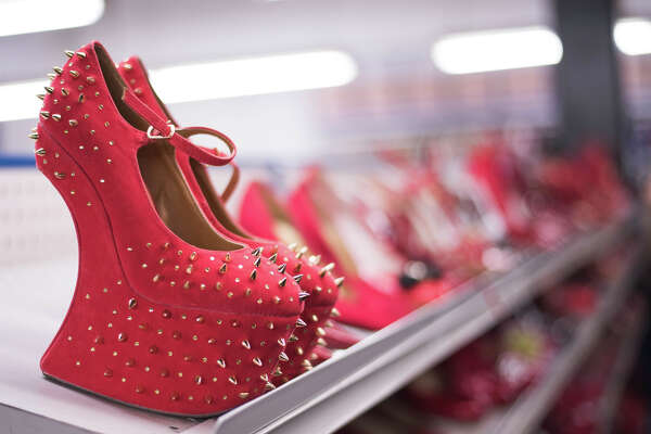 Spiky platform heels greet shoppers in the red shoe aisle during Seattle Goodwill's annual Glitter Sale on Saturday, Nov. 11, 2017.