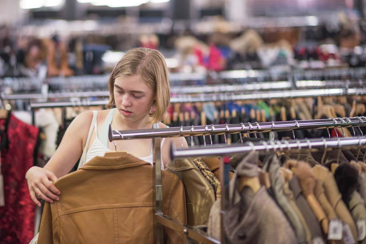 A shopper browses jackets.