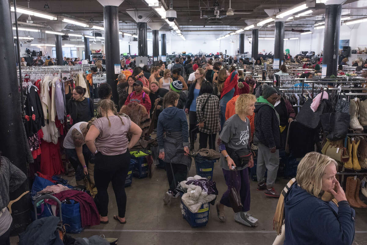 A limited number of shoppers can attend Seattle Goodwill's annual Glitter Sale at any given moment, but the aisles are still packed on Saturday, Nov. 11, 2017.