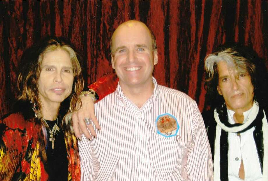Paul E. Breunich of Stamford, center, visiting with Aerosmith's Steven Tyler, left, and Joe Perry backstage at Mohegan Sun. Photo: Contributed Photo / Greenwich Time Contributed