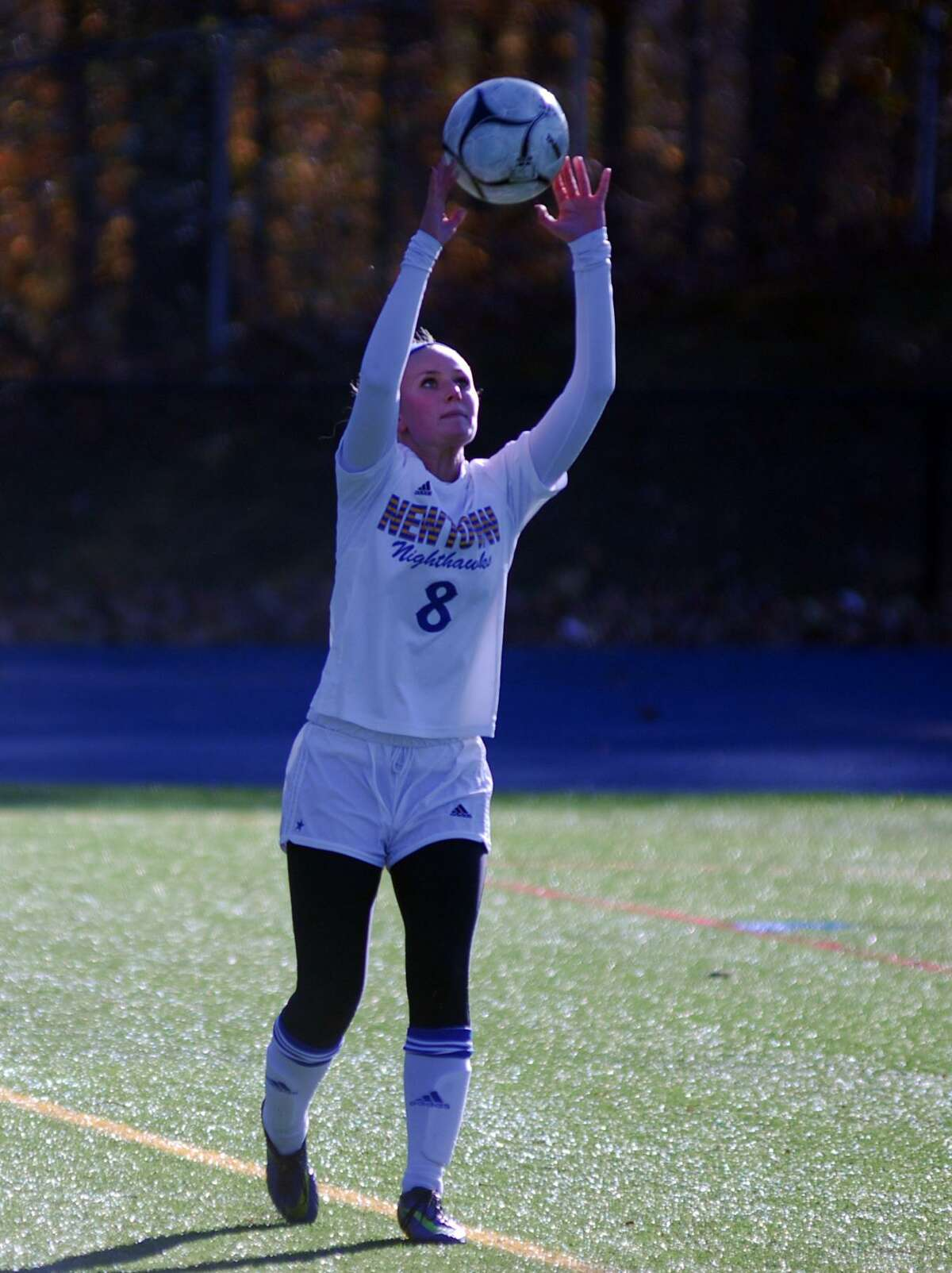 Newtown's Cassidy Kortze lines up a throw-in during a game against Glastonbury on Saturday.