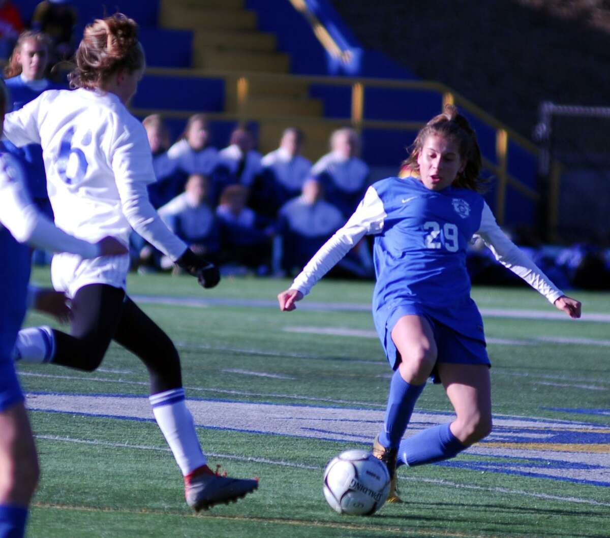 Glastonbury's Alexandra Bedard makes a sliding challenge during a 2-1 win over Newtown in the Class LL girls soccer quarterfinals on Saturday.