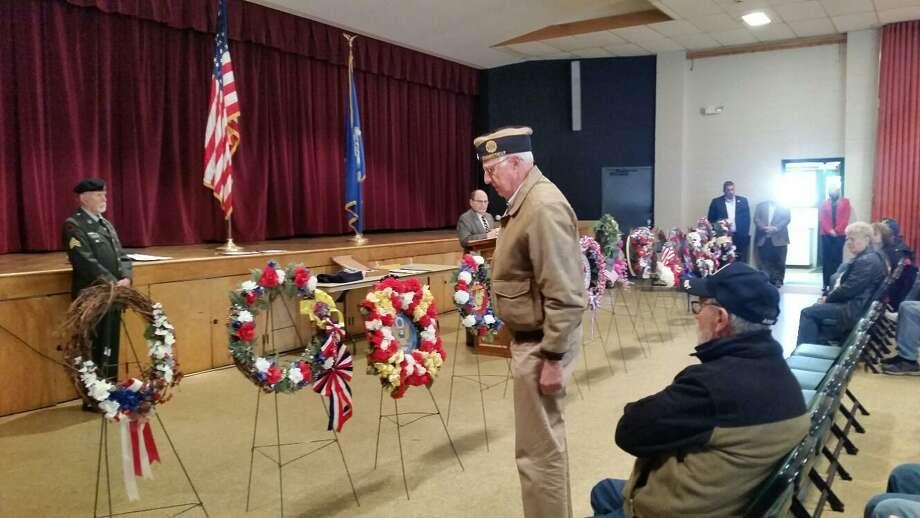 United States Air Force veteran airman Joe Pathe salutes the wreath from Torrington's American Legion Post 38. Photo: NF Ambery