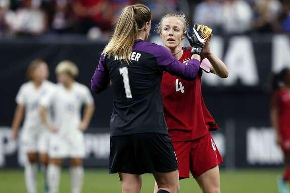 U.S. goalie Alyssa Naeher (1) is congratulated by defender Becky Sauerbrunn (4) after an international friendly women's soccer match against South Korea in New Orleans, Thursday, Oct. 19, 2017. The United States won 3-1. (AP Photo/Gerald Herbert)