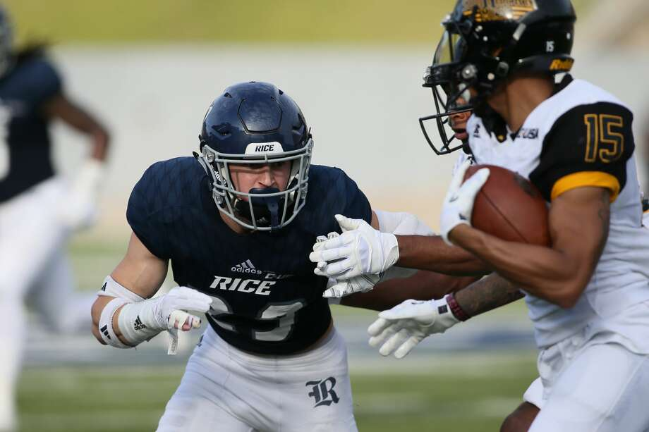 November 11, 2017:  Rice Owls safety reaches to tackle Southern Miss Golden Eagles wide receiver Allenzae Staggers during the college football game between the Southern Miss Golden Eagles and Rice Owls at Rice Stadium in Houston, Texas. (Leslie Plaza Johnson/Freelance Photo: Leslie Plaza Johnson/For The Chronicle