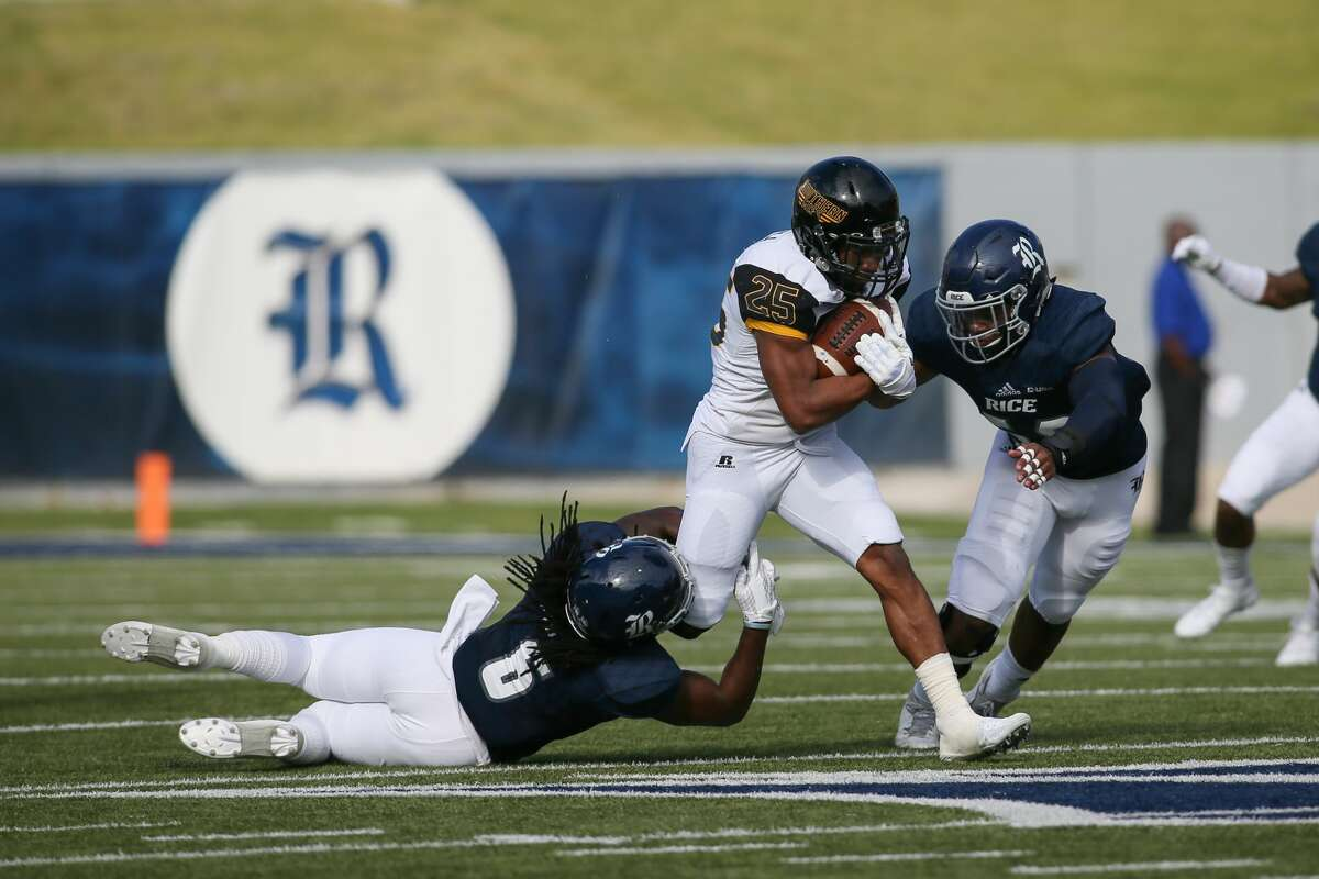 November 11, 2017: Rice Owls safety Destri White reaches out to tackle Southern Miss Golden Eagles running back George Payne during the college football game between the Southern Miss Golden Eagles and Rice Owls at Rice Stadium in Houston, Texas. (Leslie Plaza Johnson/Freelance