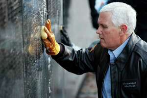 Vice President Mike Pence was among the volunteers who cleaned the Vietnam Veterans Memorial on Saturday.