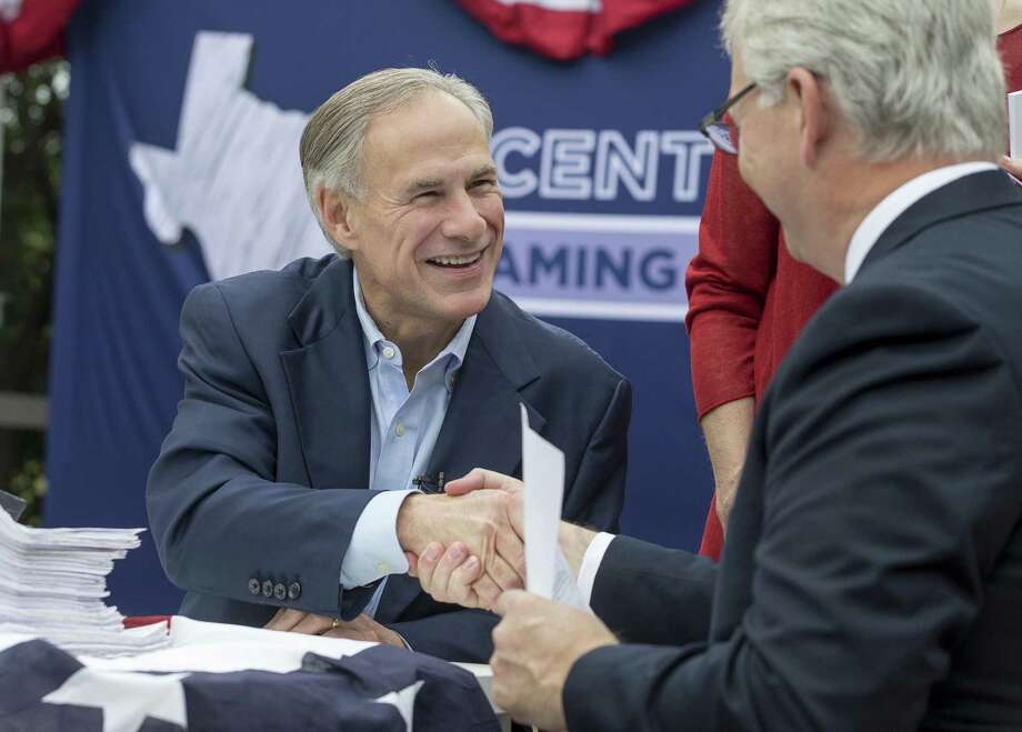 Gov. Greg Abbott shakes hands with State Republican Party Chairman James Dickey during a picnic celebrating his reelection filing day announcement at The American Legion- Charles Johnson House in Austin Saturday, Nov. 11, 2017. (Stephen Spillman / for Express-News) Photo: Stephen Spillman / Stephen Spillman / stephenspillman@me.com Stephen Spillman