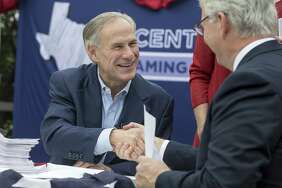 Gov. Greg Abbott shakes hands with State Republican Party Chairman James Dickey during a picnic celebrating his reelection filing day announcement at The American Legion- Charles Johnson House in Austin Saturday, Nov. 11, 2017. (Stephen Spillman / for Express-News)