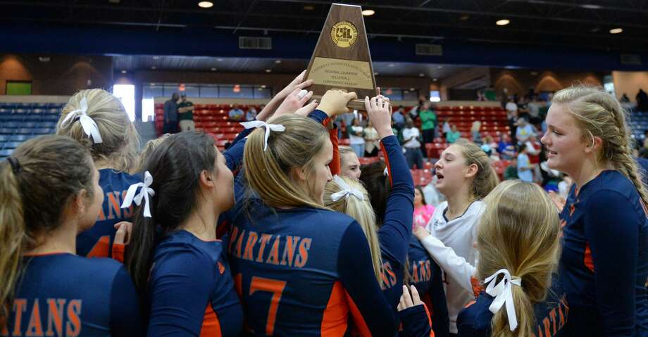 The Seven Lakes Spartans celebrate their victory in the Class 6A Region III volleyball finals over the Clear Falls Knights on November 11, 2017 at Wheeler Field House, Sugar Land,  TX. Photo: Craig Moseley/Houston Chronicle