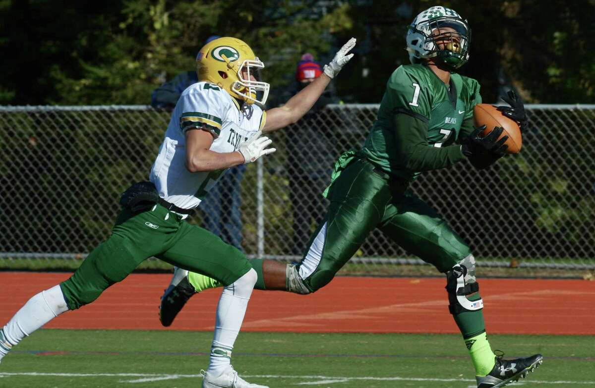 #! Jalen Elliott of the Norwalk High School Bears comes down with a touchdown reception as #2 for Trintity, Johnn Petrizzi defends as Norwalk takes on Trinity Catholic Saturday, November 11, 2017, in their FCIAC football match-up in Norwalk, Conn