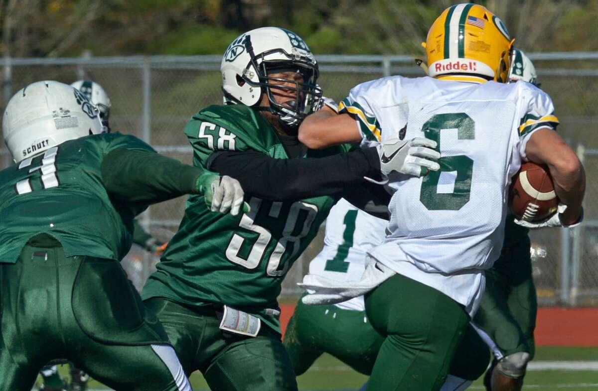 #58 for the Norwalk High School Bears, Niar Brown tackles #6 for Trinity, Jason Svec, as the Bears take on Trinity Catholic Saturday, November 11, 2017, in their FCIAC football match-up in Norwalk, Conn