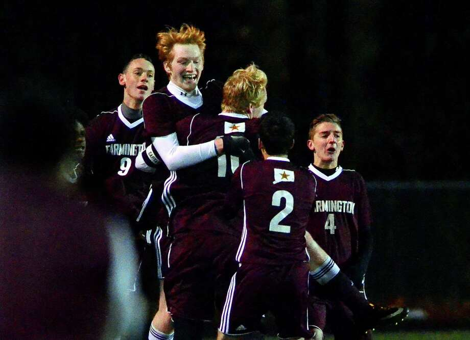 Farmington's Nate Hughes, facing camera, celebrates a goal against Shelton with teammates during Class LL boys soccer state tournament action in Shelton, Conn., on Saturday Nov. 11, 2017. Photo: Christian Abraham / Hearst Connecticut Media / Connecticut Post