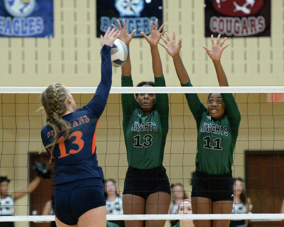 Anita Parrott (13) and Rachel Brown (11) of Clear Falls attempt to block a shot by Dani Batenhorst (13) of Seven Lakes in the second set of a Class 6A Region III volleyball finals between the Seven Lakes Spartans and the Clear Falls Knights on November 11, 2017 at Wheeler Field House, Sugar Land,  TX. Photo: Craig Moseley, Staff / ©2017 Houston Chronicle