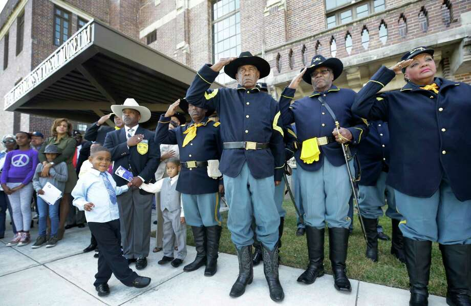 Buffalo Soldiers salute during ceremonies recognizing the opening of the third-floor expansion of the Buffalo Soldiers National Museum on Saturday, Veterans Day, in Houston. Photo: Melissa Phillip, Houston Chronicle / © 2017 Houston Chronicle