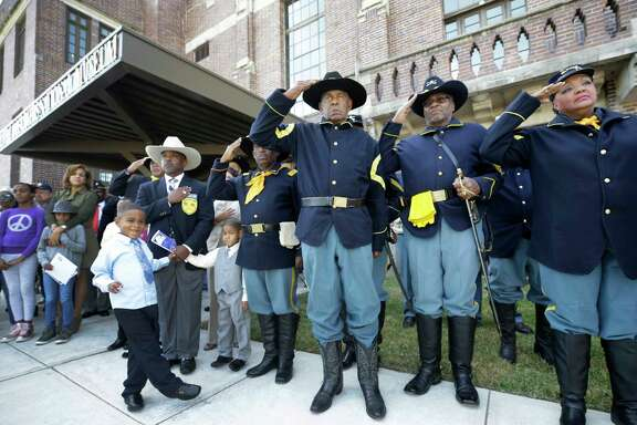 Buffalo Soldiers salute during ceremonies recognizing the opening of the third-floor expansion of the Buffalo Soldiers National Museum on Saturday, Veterans Day, in Houston.