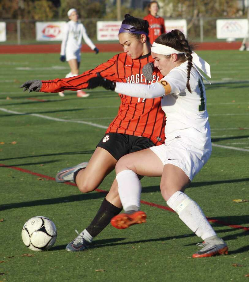 Ridgefield's Tasha Riek, left, and Enfield's Delaney Lawler battle for control of the ball during the Class LL state quarterfinal girls soccer game at Enfield High School Nov. 11, 2017. Photo: Richard Gregory / Richard Gregory