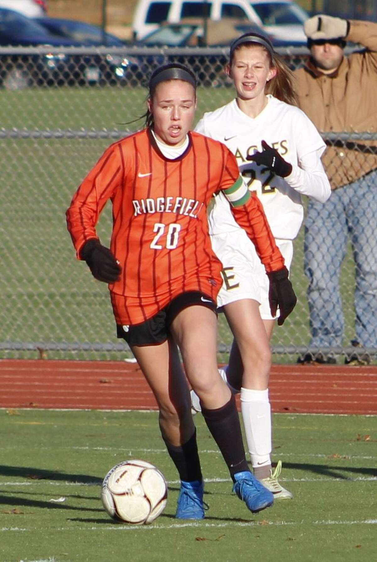 Ridgefield's Erika Linke, front, moves the ball upfield as Enfield's Madison Daly gives chase during the Class LL state quarterfinal girls soccer game at Enfield High School Nov. 11, 2017.