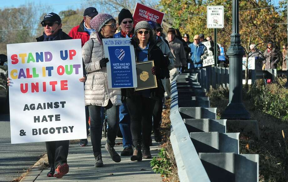 A march against hate and bigotry organized by Scott Milnor and Susan Cutler moves through Wilton Center from the Wilton Train Station Saturday, November 11, 2017, in Wilton, Conn. While their specific act of protest is a reaction to the anti-Semitic note found on a sixth-grader's locker at Middlebrook, Saturday's march is aimed at all acts of intolerance, bigotry and hate. Photo: Erik Trautmann / Hearst Connecticut Media / Norwalk Hour