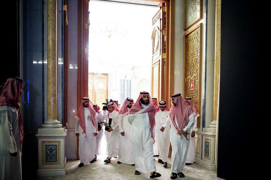 Crown Prince Mohammed bin Salman, center, arrives at the Future Investment Initiative in Riyadh, Saudi Arabia, Oct. 23, 2017. A midnight blitz of arrests ordered by the crown prince of Saudi Arabia that included dozens of influential figures appears to be the most sweeping transformation in the kingdomé•s governance for more than eight decades. (Tasneem Alsultan/The New York Times) Photo: TASNEEM ALSULTAN, STR / NYTNS