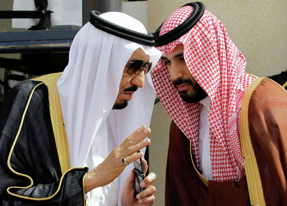 FILE - In this May 14, 2012 file photo, King Salman, left, speaks with his son, now Crown Prince Mohammed Bin Salman. Photo: Hassan Ammar, STF