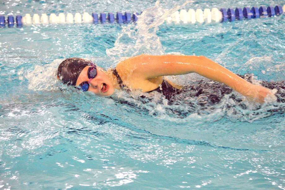 Edwardsville senior Emily Webb competes in the 500-yard freestyle during the Edwardsville Sectional, which was held Saturday at the Chuck Fruit Aquatic Center.
