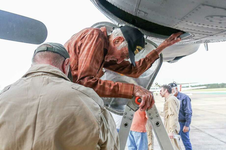 World War II veteran James Bivin, 95, exits a B-17 Flying Fortress after going on a flight Saturday at Conroe-North Houston Regional Airport. Photo: Michael Minasi, Staff Photographer / © 2017 Houston Chronicle