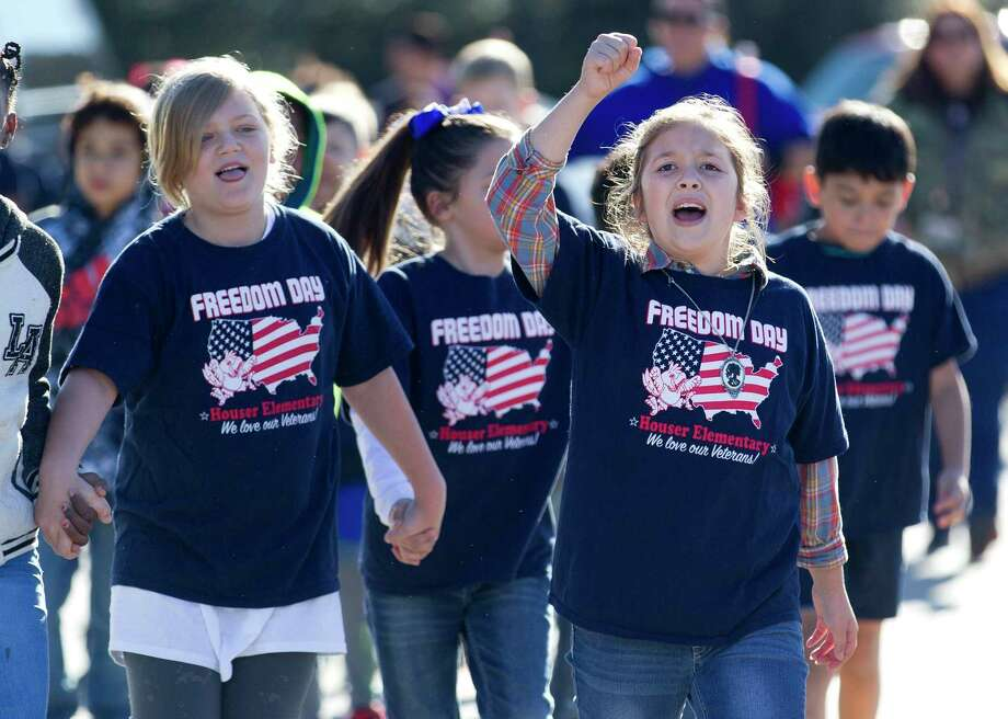Students from Houser Elementary School cheer as they make their way to Oak Ridge High School for a Veteran's Day celebration event, Friday, Nov. 10, 2017, in Shenandoah. Photo: Jason Fochtman, Staff Photographer / © 2017 Houston Chronicle