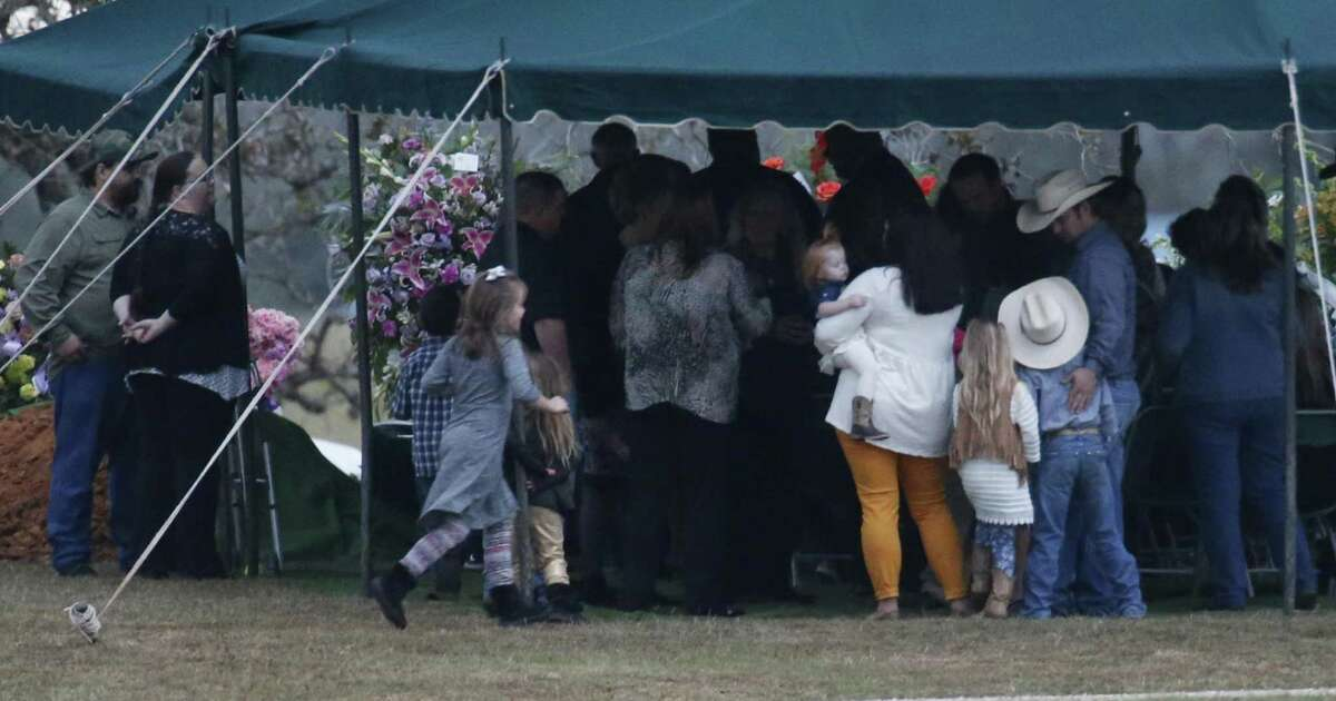 Mourners stand under the tent after funeral services for Therese and Ricardo Rodriguez in Sutherland Springs on Saturday, Nov. 11, 2017. The couple were amongst the 26 killed in last Sunday's shootings at First Baptist Church in Sutherland Springs. (Kin Man Hui/San Antonio Express-News)