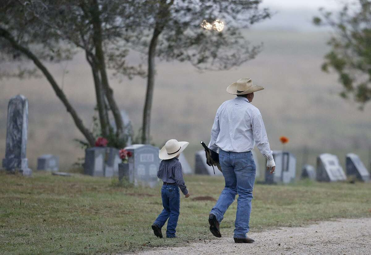 Mourners enter the Sutherland Springs Cemetery during the funeral of Sutherland Springs shooting victims Therese and Ricardo Rodriguez Saturday, Nov. 11, 2017.